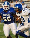 Lutheran East Football Wins on the Road image